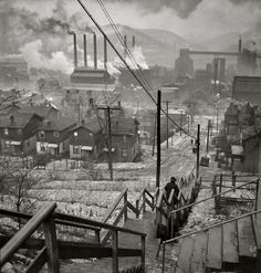 Jack Delano's 1940 photo of Pittsburgh has a cinematic feel to it, as the lady on the staircase descends into a dark and cold and spectacular kind of hell. Description from holeintheclouds.net. I searched for this on bing.com/images