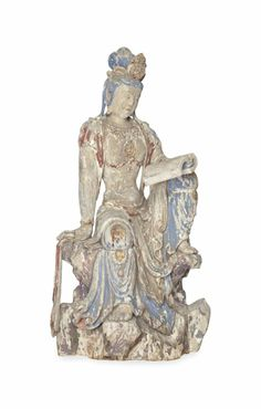 A CHINESE CARVED AND PAINTED WOOD FIGURE OF A SEATED GUANYIN, seated atop a rockwork base