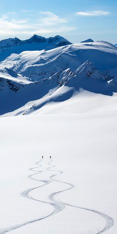 Like two love birds pecking their name into wood, we make our own mark in the beauty of snow. www.norrona.com