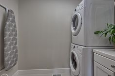 Main level laundry with access to garage. #Fresco