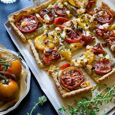 Tomato Tart With Pesto & Onions With Fresh Tomatoes, Pesto, Onions, Goat Cheese, Fresh Thyme Leaves, Cracked Black Pepper, Sea Salt, Pinenuts, Walnut Halves, Black Peppercorns, Garlic, Basil Leaves, Parmigiano Reggiano Cheese, Fresh Lemon Juice, Sea Salt, Olive Oil