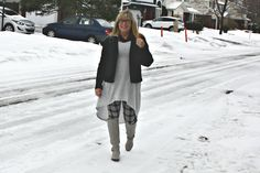 Moto jacket with grey hi lo tunic, plaid leggings and tall grey boots
