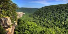 ARKANSAS: The Ozark region is breathtaking, with its steep-sloping plateaus, drastic drops in elevation, and as-far-as-the-eye-can-see wooded mountains. Source Arkansas Geological Survey