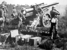 Las mejores fotos de la segunda guerra mundialUn obús pesado Alemán, sFH 18, de 150 mm. presto a disparar.