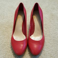 "Nine West Red Heels Red heels with rounded toes.   3"" heel.  Has scratch on one shoe and peeling inside both shoes. Nine West Shoes"