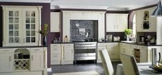 Stylish Kitchen Ideas with Modern Appliances: Kitchen Purple Walls And White Furniture (I really like the moldings)