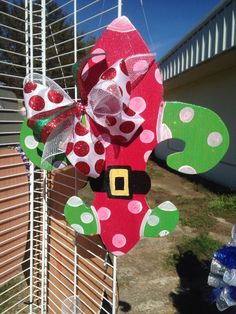 Order your fleur de lis door hanger. All wood with a touch of glitter to give it that extra sparkle. You will love it.