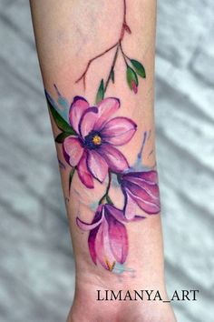 This plumb and purple color Wrist Tattoos, Body Tattoos, Sleeve Tattoos, Tatoos, Colorful Flower Tattoo, Tiny Flower Tattoos, Peacock Feather Tattoo, Rainbow Tattoos, Blackout Tattoo