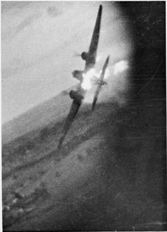 "Still from camera gun footage shot from a Hawker Typhoon Mark IB flown by Flying Officer J M G ""Plum"" Plamondon, RCAF of No. 198 Squadron RAF, as he shot down a Junkers Ju 88 during a sortie over northern France. Cannon shells strike the fuselage of the Ju 88 which burst into flames and crashed from 50 feet shortly after."