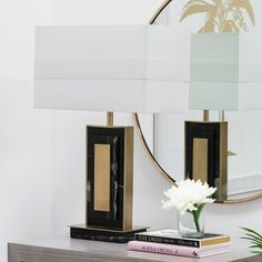 Resembling a towering Art-Deco building, the Walton Table Lamp is a stylish way to enhance your home. The contrasting brass and black marble finishes give this piece a luxurious feel and the included shade is a perfect match.