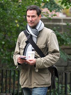 Trying a different approach? Keanu Reeves steps out clean-shaven in New York on Wednesday ...