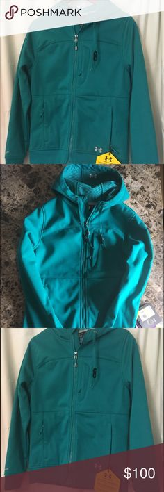 Under Armour Soft Shell Cold Gear Hooded Jacket New with Tags Women's Under Armour Storm Soft Shell Jacket Cold Gear Infrared Hooded. Color is a teal green color, took many photos as it looks different in various lighting. Has one chest pocket and two lower front pockets. Under Armour Jackets & Coats