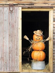 Scarecrow pumpkin - stack 3 pumpkins, insert rebar or rod through center; add straw hat, mini-brooms for hands & arms, create face with carvings or marker, add raffia scarf & mount on inverted tub!