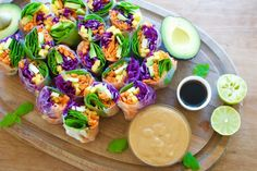 Colorful veggie rice paper rolls with peanut butter sauce