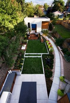 Garden - Minimalist And Cool Backyard Designs Of Home With Tidy Turfs And Curving Walk Way Covered By Concrete Base: Awesome Backyard Designs Ideas for Relaxing Living Space Concept
