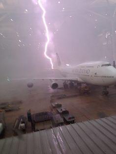 Incredible photo of lightning striking an Air New Zealand 747 at Brisbane International Airport.