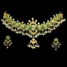 Antique, 19th century Mughal necklace from India, made of 22K yellow gold and studded with 14ct diamonds and Basara pearls. This stunning Indian necklace and earring set will make its next wearer a virtual empress! www.jewelofthelotus.com
