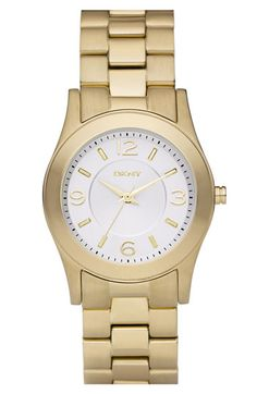 Watch: Essential because It's big enough too look like a boyfriend watch, but small enough for my wrists to be in style once that fad goes out. | DKNY Small Round Bracelet Watch