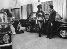 ᙖℓąƈƙ & ᏇᏲᎥ৳ҽ Ƥђσ৳σʂ ~ © Neal Boenzi/The New York Times,  A model in a bikini presents a LADA at a motor show in New York, 1973.