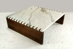 Khouri,Guzman,Bunce Limited-  Calacatta marble top with solid walnut sides and box joint detail.