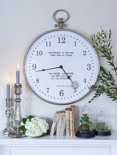 Large wall clock original message saying candlestick flowers plants books