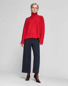 These beautifully tailored wide leg navy cropped trousers are easy and flattering. They will take you through the working day and into evening. Shop now!
