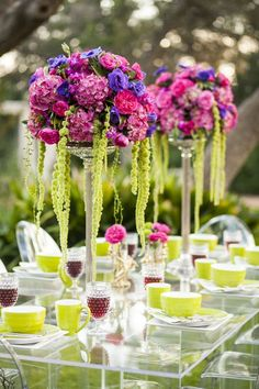 Blue, Pink, Purple, Green, Lime, Black and White inspired floral shoot, featuring cow hide print table runners, plexiglass acrylic table, and ghost chairs. SMS Photography, and styling by Flora Fetish. Rentals by Premiere Party Central http://www.PremierePartyCentral.com #ATXWedding #rental #styledshoot