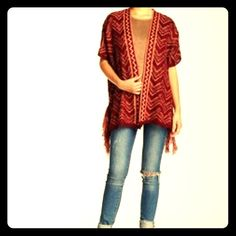 NWT Romeo & Juliet fringe cardigan This  lightweight cardigan is great for layering and works for all seasons. Aztec inspired print and fringe detail on either side. Has short sleeves . Port wine and light apricot color. Beautiful piece. Brand new- open to offers on this item . first pic for modeling purposes- all others are actual sweater you will receive Romeo & Juliet Couture Sweaters Cardigans