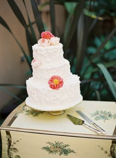 Simple and chic' wedding cake with carefully placed flowers on each layer..