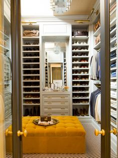 A nice walk-in closet with seating.