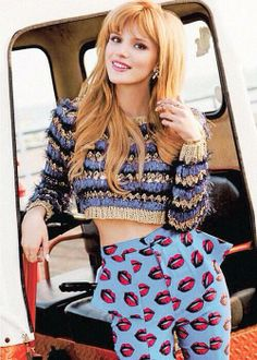 Bella Thorne. Wow she grew up and looks a lot better now. I didn't even know this was her at first.