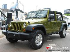 a 4 door jeep wrangler rubicon!  i wish we could trade in my pt cruiser convertible.  hopefully within the next year...