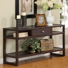@Overstock - Complete your living room with this Hilda Blaine sofa table  Open shelves on either side of central drawer make this furniture piece functional  Sofa table can stand alone or sturdily display any of your household accents  http://www.overstock.com/Home-Garden/Hilda-Blaine-Espresso-Sofa-Table/4657737/product.html?CID=214117 $269.99