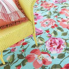 This bright floral wool micro hooked rug brings floral accents and bold colors to your floor decor.