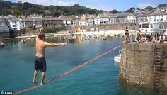 Tightrope walking at Mousehole, Cornwall.