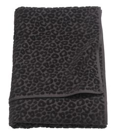 Black. Bath towel in cotton terry with a jacquard-weave leopard pattern. Hanger…
