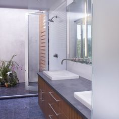Shower opens to outside, storage, dual sinks/John Lum Architects