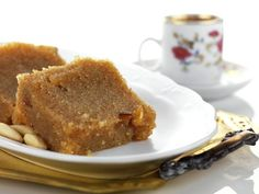 Coarse semolina is toasted in oil and then bathed in hot syrup that is flavored with cinnamon, cloves and orange peel. A simple and elegant dessert that can also be enjoyed during the Lenten season.