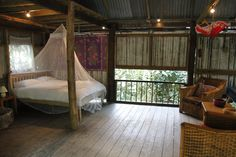 A bridal bed set up in the malaysian hut in the rainforest biome