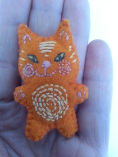 Tiny felt cat