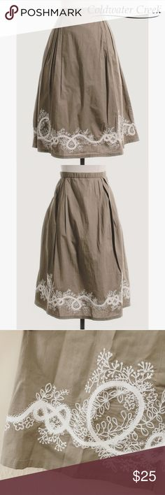 """NWOT Coldwater Creek Floral Embroidered Skirt Never worn, NEW without Tags, absolutely darling skirt from Coldwater Creek. PERFECT condition, tan, A-line skirt with white border embroidery. Skirt is fully lined with partial elastic waist and zipper closure. Measures approximately 25"""" Long. Size Petite Small. From my smoke free home. Coldwater Creek Skirts A-Line or Full"""