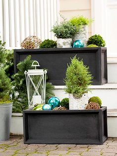 Take It Outside  Instead of storing your planters for the winter months, use them to create a Christmas landscape. These winter-worthy composite planters serve as a base for an ensemble of small cypress plantings in birch-bark tubes. Fill in your display with moss, grapevine spheres, and oversize glass ornaments.