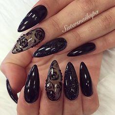 Stylish black stilleto nail design