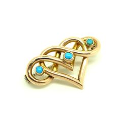 2bb90b572 Antique Victorian brooch featuring a hear shape with round turquoise  gemstones. The brooch is set