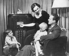 1920s | family catches the latest serial dramas, comedies, sporting events on the radio