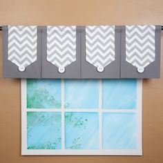 @Overstock - This decorative valance features our hot grey and white chevron banner. It is layered on a classic grey fabric panel with a sleek black fabric on the back, making this valance reversible.  http://www.overstock.com/Home-Garden/Design-Your-Valance-Four-panel-Chevron-Valance/7870057/product.html?CID=214117 $165.00