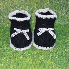 Knitted baby booties- black and whtie. $9.99 Our Knitted baby booties keep your baby's little feet warm and comfy. They're knitted from soft wool that doesn't irritate your baby's skin. Material: 100 % Acrylic. Sizes from Newborn to 12 months.