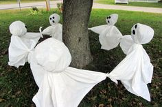 Ring around the rosy ghosts    Green yard sticks (used for keeping tall plants from tipping over)   PVC pipe (1-1 1/2 inch)   white garbage bags   clear zip ties   white shower curtains from the dollar store   black felt   hot glue gun and glue   newspaper