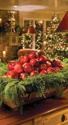 As simple & inexpensive way to bring some rustic Christmas cheer to your table - a bowl full of apples and evergreen tree trimmings. Noel Christmas, Primitive Christmas, Country Christmas, All Things Christmas, Winter Christmas, Christmas Crafts, Natural Christmas, Christmas Colors, Simple Christmas