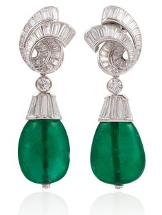 DAVID WEBB OUTSTANDING PAIR OF EMERALD AND DIAMOND EARRINGS. CERTIFICATES Composed with two magnificent emeralds drop shaped beads of approximately 29 and 28 carats, suspended by round and baguette shaped diamond platinum earclips.